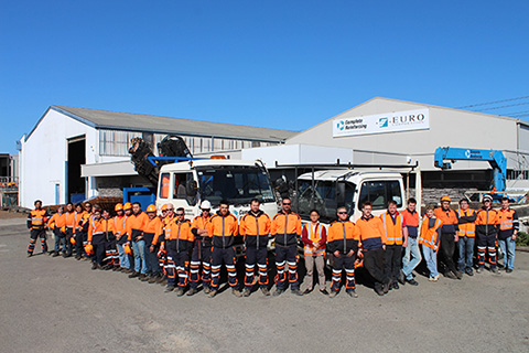 Complete Reinforcing Christchurch NZ team standing in front of steel plant